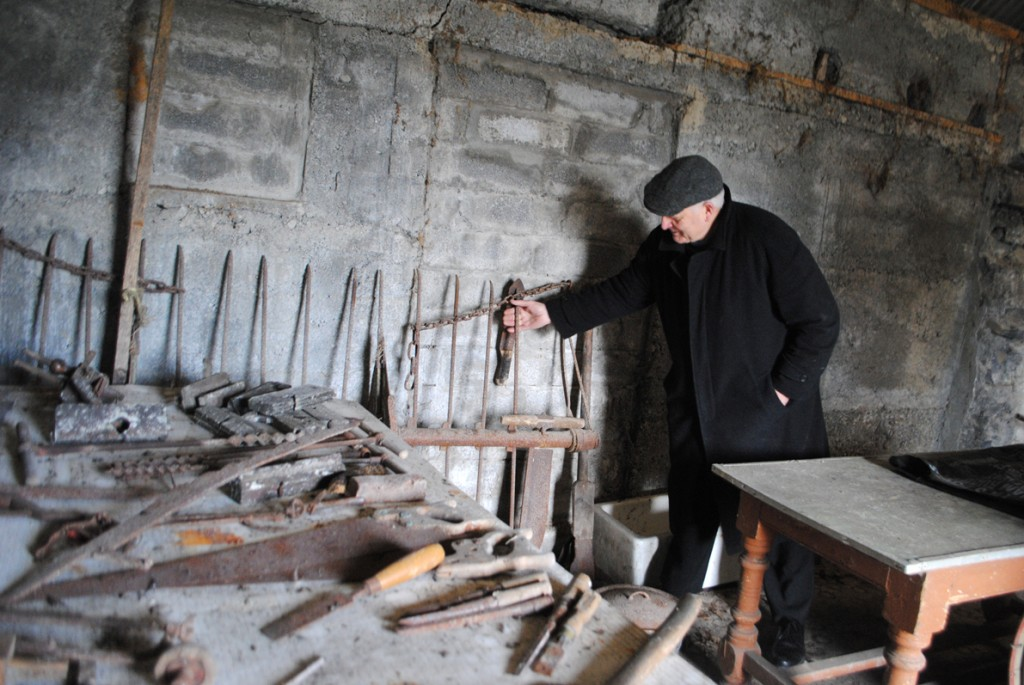 Pictured is Seamus O'Connell in the current derelict shed, which will be demolished and rebuilt into a Carpenters Museum and Interpretive Centre.