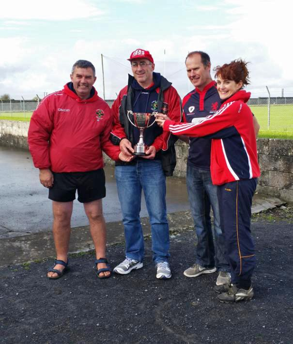 Pictured are the U15 Squad Mentors, Tom Cogley, Thomas Grealish, Eamon Fox and Rita Healy, with the much coveted cup.