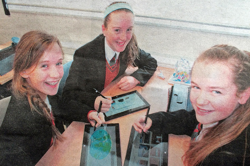 Pictured are Coláiste Bhaile Chláir students Vicka Mulroy, Niamh McGrath and Nicola King experiencing the benefits of technology in education. Photo via Irish Independent.