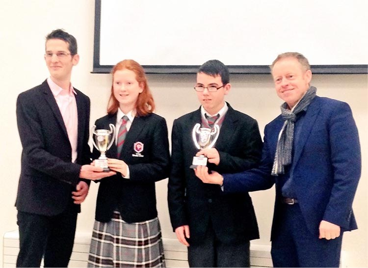 Ciarán Cannon TD and Isaac Burke NUIG present the Mathletes trophies to top first year students Daire Leonard and Sinéad King.