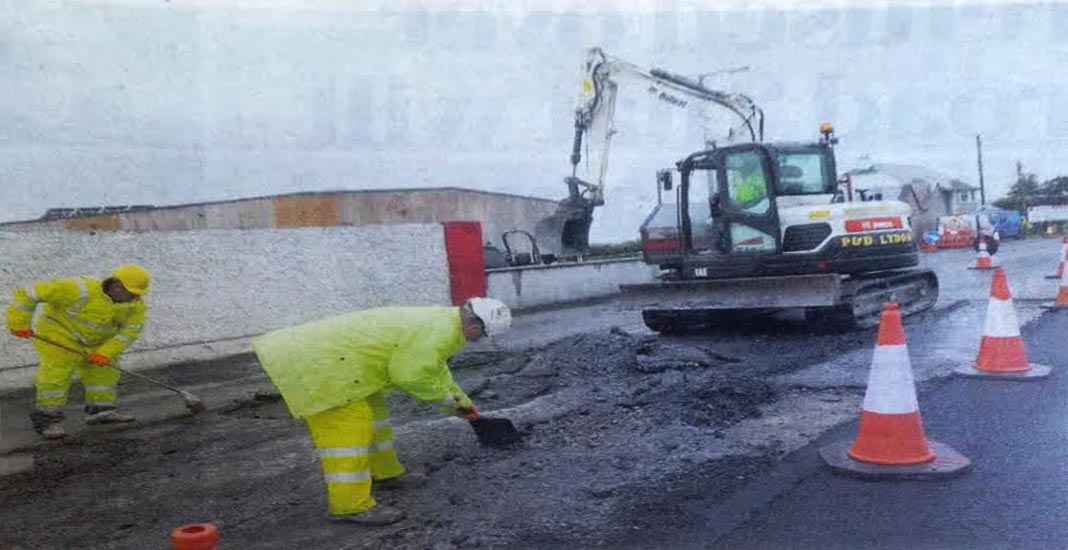 Workmen repairing the collapsed stretch of road in Carnmore yesterday. Photo by Stan Shelds.