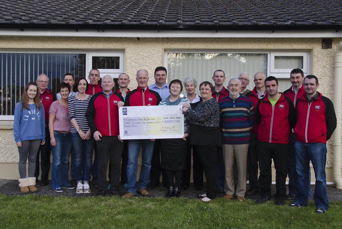 Members of Clare River Harriers presenting a cheque to Claregalway & District Day Care Centre.
