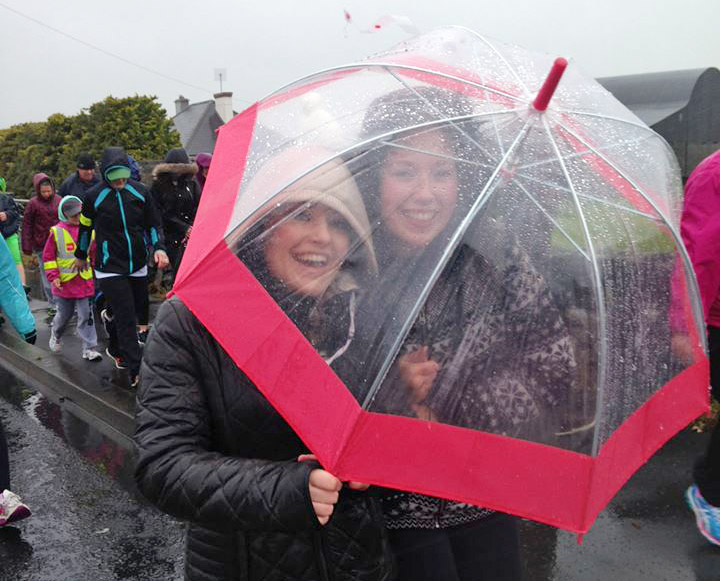 Eva Higgins and Emer Walsh keeping dry during the walk!