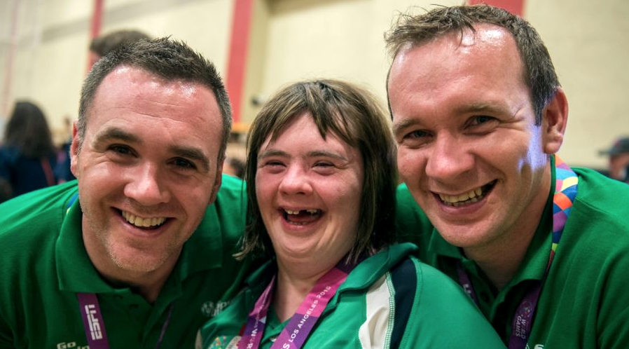 Lorraine Hession, a member of Team South Galway, from Turloughmore, Co Galway, celebrates with her brothers, Paul (L) and Joseph (R), after being presented with her 4th place ribbon for her swim in the AQ 100M Freestyle Division F14 event at the Uytengsu Aquatics Center. Photograph: Ray McManus/Sportsfile via Irish Independent.