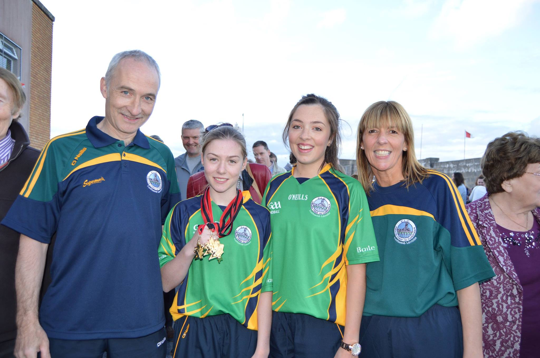 World Handball Champion Niamh Heffernan with her parents and sister Michelle at the homecoming in Carnmore Community Centre recently (Photo by Josette Farrell).