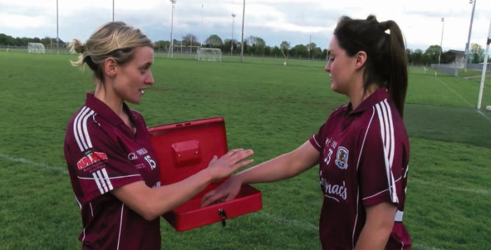 Galway ladies football captain Edel Concannon (left) takes charge of Deirdre Brennan's smart phone as the squad undertake a novel venture to raise awareness about the effects smart phones and social media can have on mental health.