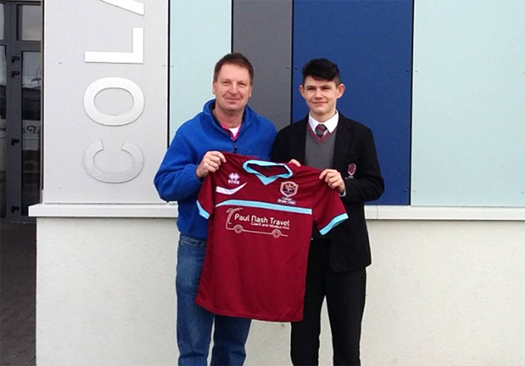 Pictured is Paul Nash presenting the kit to the U16 captain Oisín Moughan.