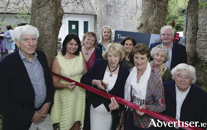 Sabina Higgins cuts the ribbon at the reopening of Yeats Castle, Thoor Ballylee on Saturday with Joe Hassett, Fidelma Healy Eames, Rena McAllen, Sr DeLourdes Fahy. Back row. Helen Monaghan, Deirdre Holmes, Angela Guillemet, Lelia Doolan, Joe Byrne. Photo: Mike Shaughnessy.