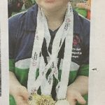 Local gymnastic star's triple gold success